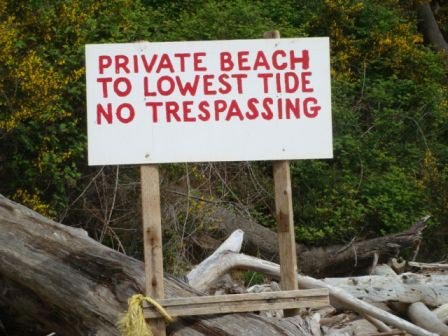 No Trespassing sign on privately owned tideland with Taylor Shellfish geoduck farm.